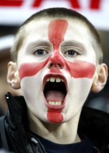 English boy painted his face in team colors